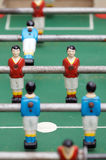 Table football. Soccer player figurines on old table football Royalty Free Stock Photos