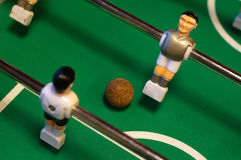 Table football competition. Table football figures in the cmpetition with ball Royalty Free Stock Images