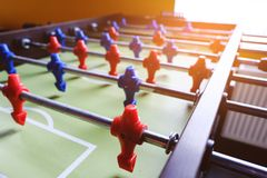 Table football in the entertainment center. Close-up image of plastic players in a football game stock image