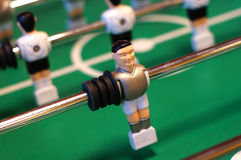 Table football figure. On the green table Stock Photos