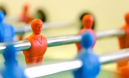 Table football, foosbal red and blue players in macro view Stock Photography