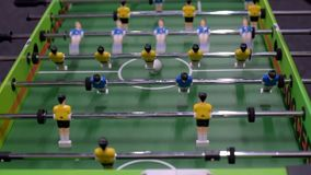 Table football game. Closeup photo of plastic players in table football game stock video