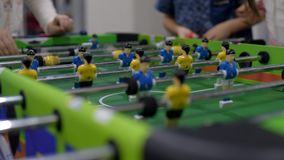 Table football game. Closeup photo of plastic players in table football game stock footage