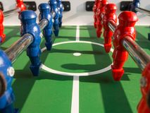 Table football game with red and blue players team Royalty Free Stock Photography