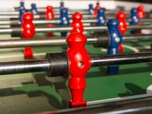 Table football game with red and blue players team Stock Photo