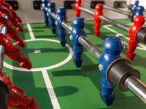 Table football game with red and blue players team Royalty Free Stock Image