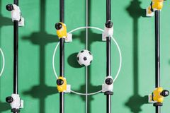 Table football game with white and yellow players team in table football kicker game Royalty Free Stock Images