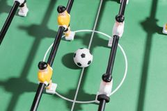 Table football game with white and yellow players team in table football kicker game Stock Image