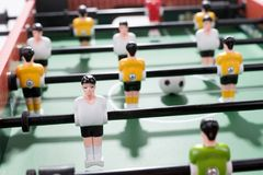 Table football game with white and yellow players team in table football kicker game Stock Photo