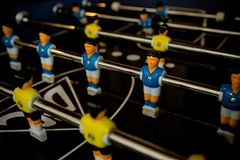 Table football game with yellow and blue players.Selective focus.able Football Game Hobby or Leisure.sport team football stock photos