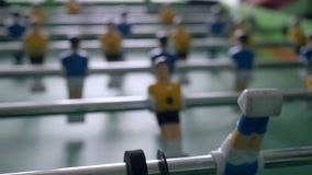 Table football game with yellow and blue players stock video