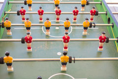 Table football game with yellow and red players. Table football game with yellow and red small players Royalty Free Stock Photos
