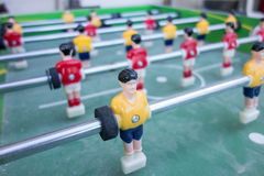 Table football game with yellow and red players Royalty Free Stock Image