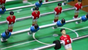 Table football, plastic figures of soccer players moving on foosball field, pub. Stock footage stock video