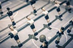 Table football players rotating to kick ball royalty free stock images