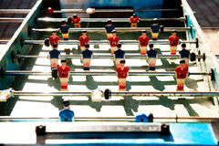 Table football with red team and blue. In a sunny day Stock Photo