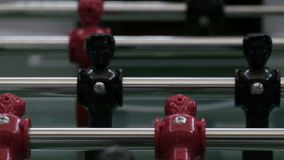 Table football soccer. The figures for the game of table football spinning. Close-up. Invisible Unknown people playing. Table football soccer. Invisible Unknown stock footage