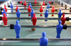 Table football,table soccer,foosball,kicker. Attacker in focus royalty free stock photography