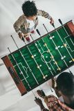 Table football. Top view of father and little son playing table football Royalty Free Stock Image