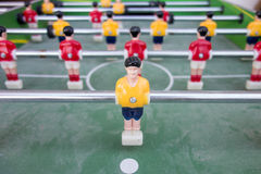 Table football with yellow and red players Stock Images