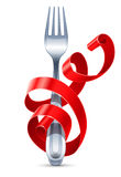 Table fork braided by red ribbon Royalty Free Stock Photos