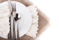 Table fork and knife in a napkin Royalty Free Stock Images