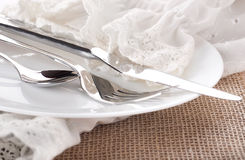 Table fork and knife in a napkin Stock Photos