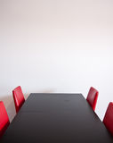 Table and four chairs Stock Images