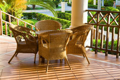 Table and four chairs on patio stock image