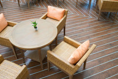 A table with four chairs  on wooden floor Stock Photo
