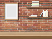 Table frame shelf brick background. Top table picture frame, bookshelf on brick wall background Royalty Free Stock Images