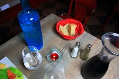 Table of a french restaurant with bread and carafe of water and wine stock photos