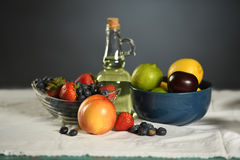 Table with Fresh Fruits. And olive oil bottle stock photos