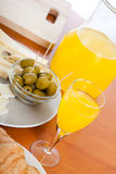 Table with fresh olives and juice Stock Photography