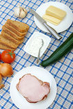 Table with fresh vegetables, meat, cheese and bread Royalty Free Stock Images