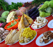 Table with fresh vegetables and mushrooms. Table with a variety of fresh vegetables and mushrooms Stock Photo