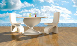 Table in front of sea Stock Photography