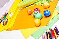 Table full of colorful eggs and craft stuff Royalty Free Stock Image