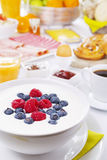 Table full with continental breakfast items, brightly lit Stock Photography