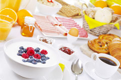 Table full with continental breakfast items Stock Photos