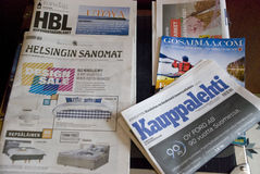 Table full of finnish newspapers, print media. Helsinki, Finland - July 21, 2016: table full of finnish newspapers, print media royalty free stock photography
