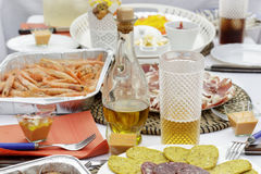 Table full of spanish cuisine products and plates Royalty Free Stock Images