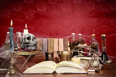Table full of witchcraft related objects. High contrast photo of a witch's table Stock Photography