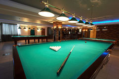 Table for game in billiards. In modern hotel royalty free stock photo