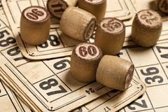 Table game Bingo. Wooden Lotto barrels with bag, playing cards for Lotto card game, leisure, play, strategy, gambling, lottery, stock images