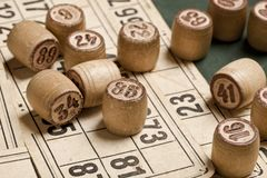 Table game Bingo. Wooden Lotto barrels with bag, playing cards for Lotto Board game, gambling, lottery, royalty free stock image
