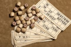 Table game Bingo. Wooden Lotto barrels with bag, playing cards for Lotto Board game, leisure, gambling, lottery,. Table game Bingo. Wooden Lotto barrels with bag