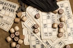 Table game Bingo. Wooden Lotto barrels with bag, playing cards for Lotto Board game, leisure, gambling, lottery, royalty free stock photo