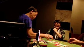Table game in Grand Villa Casino stock footage