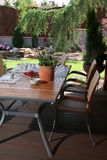 Table on garden patio Royalty Free Stock Photos